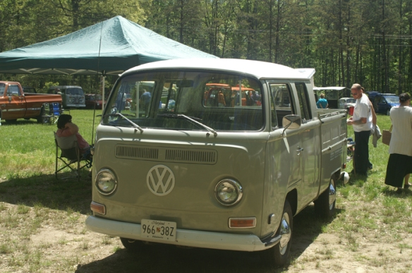 early bay window double cab sitting in the club area.  I think she'd look good next to Moby in the garage!